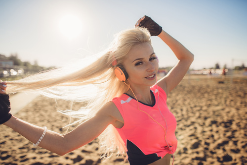 Woman with headphones is playing with hair Stock Photo