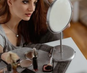 Woman with makeup before the mirror Stock Photo