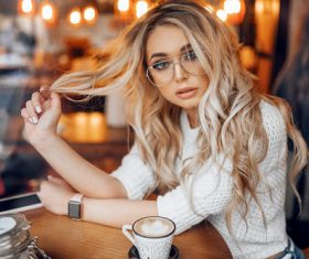 blonde women with glasses cellphone watch Stock Photo