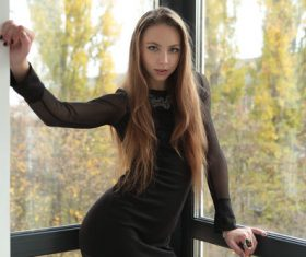 indoors black dress women Stock Photo