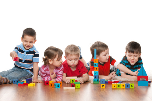 A group of children playing with building blocks Stock Photo free ...