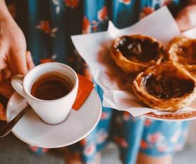 Afternoon tea coffee and custard tart Stock Photo