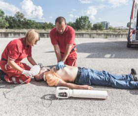 Ambulance staff give heart resuscitation to patients Stock Photo 02