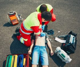 Ambulance staff give heart resuscitation to patients Stock Photo 03