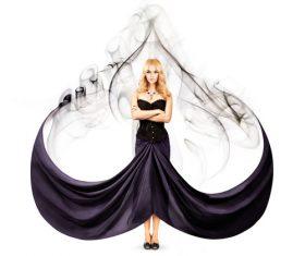 Art photo of woman wearing black maxi dress Stock Photo