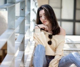 Asian woman sitting on the steps Stock Photo