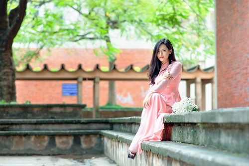 Asian woman wearing cheongsam with open toed shoes Stock Photo