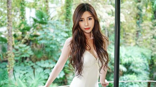 Asian woman with long shawl and big eyes Stock Photo