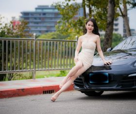 Beautiful woman with sports car Stock Photo