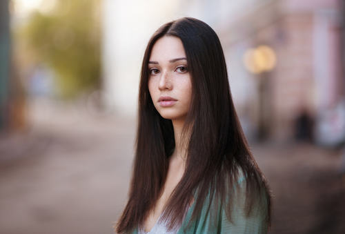 Black long hair girl with blurred background Stock Photo