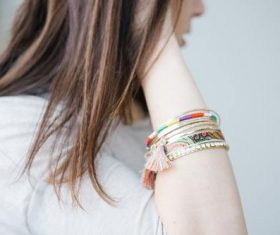 Bracelet close-up on girl arm Stock Photo