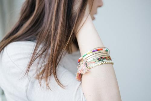 Bracelet close up on girl arm Stock Photo