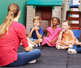 Children listen to the lectures of kindergarten teachers Stock Photo