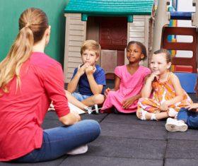 Children listen to the lectures of kindergarten teachers Stock Photo