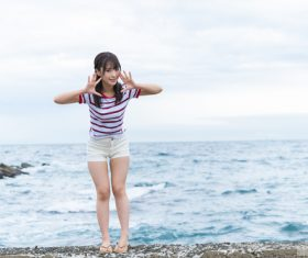 Cute Japanese girl by the sea Stock Photo