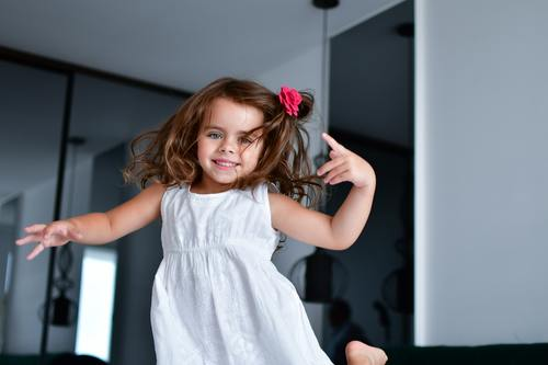 Dancing little girl Stock Photo