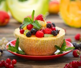 Food fruit melons blackberries raspberries mint leaves cold platter Stock Photo