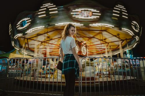 Girl in the amusement park Stock Photo