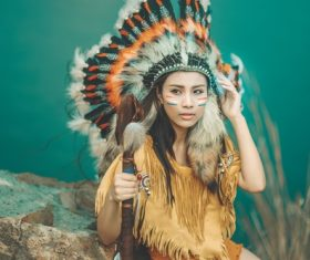 Girl soldier an Indian dress on head from feathers Stock Photo 01