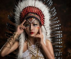 Girl soldier an Indian dress on head from feathers Stock Photo 02