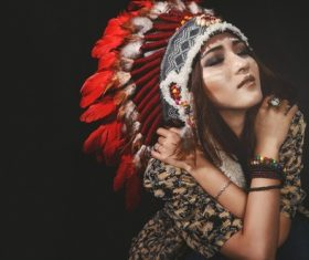 Girl soldier an Indian dress on head from feathers Stock Photo 05
