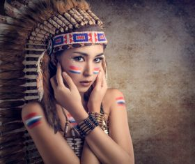 Girl soldier an Indian dress on head from feathers Stock Photo 07