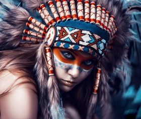 Girl soldier an Indian dress on head from feathers Stock Photo 08