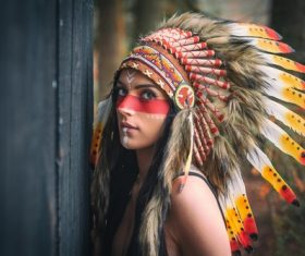Girl soldier an Indian dress on head from feathers Stock Photo 09