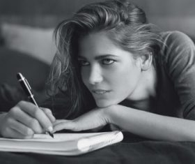 Girl writing notes Stock Photo