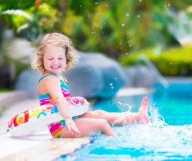 Happy children sitting by the pool Stock Photo