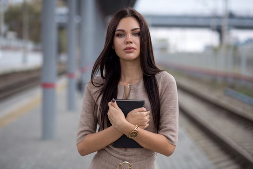Hipster woman standing at the station Stock Photo