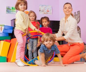 Kindergarten teacher playing with children Stock Photo 02