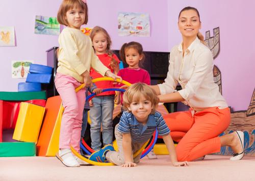 Kindergarten teacher playing with children Stock Photo 02