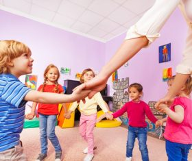 Kindergarten teacher playing with children Stock Photo 03