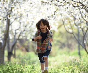 Little boy running Stock Photo
