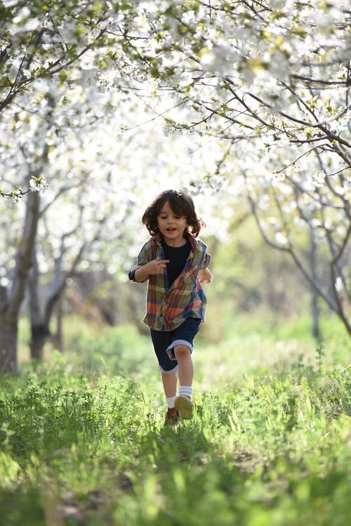 Little boy running Stock Photo