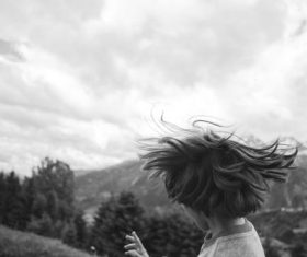 Little boy swinging hair Stock Photo