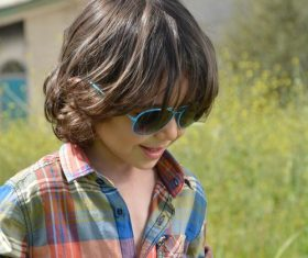 Little boy with sunglasses Stock Photo