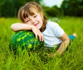 Little girl and watermelon on the grass Stock Photo