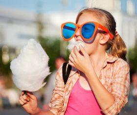 Little girl eating marshmallow Stock Photo
