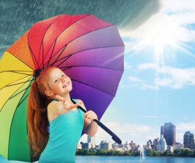 Little girl hold up an umbrella Stock Photo