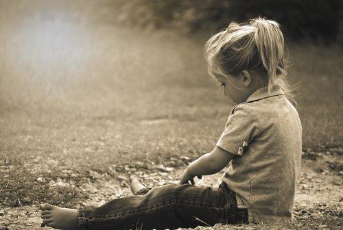 little girl sit ground Stocksy United