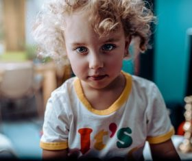 Little girl with blond curly hair Stock Photo