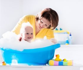 Mothers take care of bathing babies Stock Photo