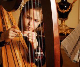 People playing harp Stock Photo 02