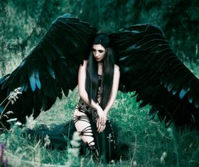 Pretty girl-demon with black wings Stock Photo 03
