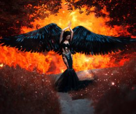 Pretty girl-demon with black wings Stock Photo 06