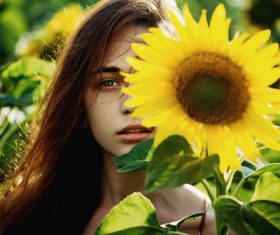 Pretty girl holding sun flower Stock Photo