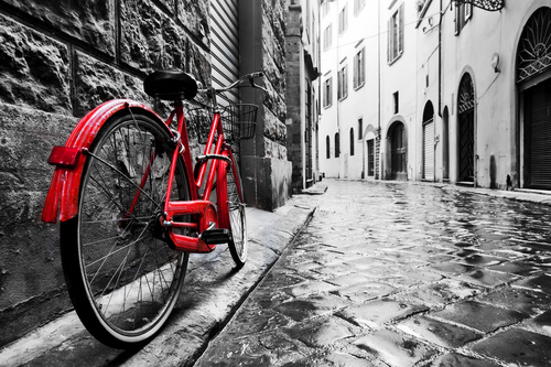 Red bicycle parked on the street Stock Photo