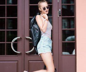 Sling hot pants girl in front of the door Stock Photo